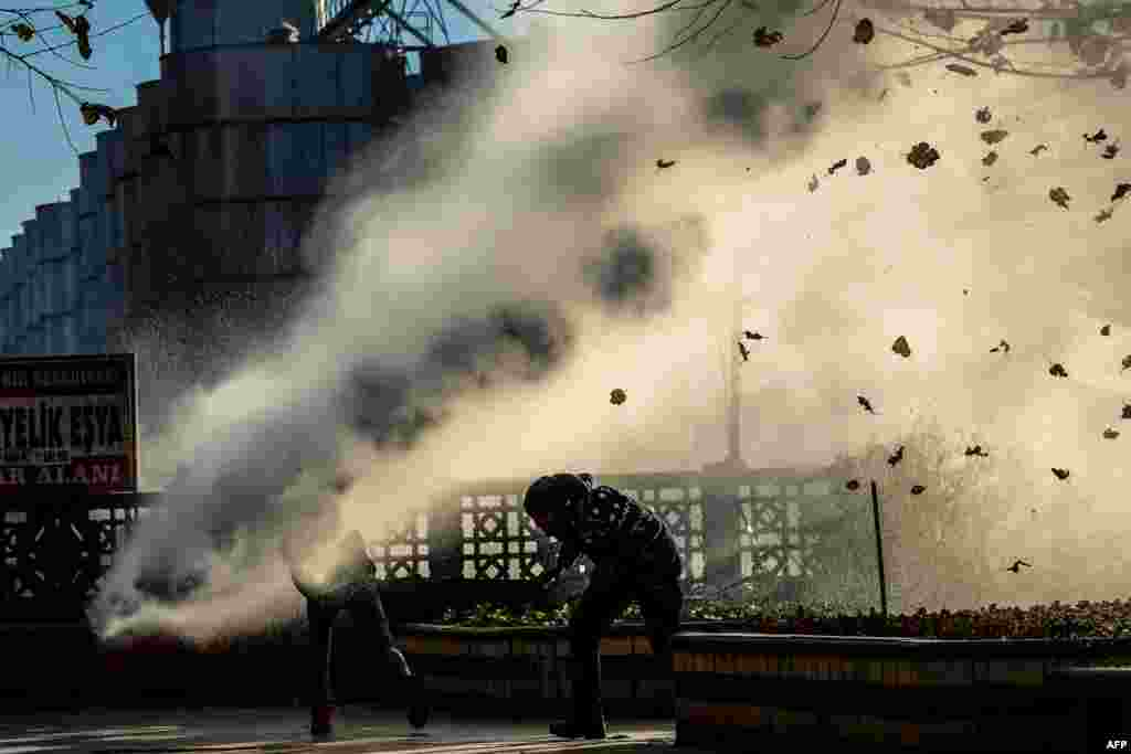 Turkish riot police use a water cannon to disperse protesters from Diyarbakir's historic Sur district which has been placed under a curfew following the killing of a prominent Kurdish lawyer in the city on November 28. (AFP/Ilyas Akengin)