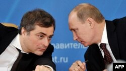 While no longer in charge of relations with Ukraine, Vladisalv Surkov (left), still seems to be of one mind with Vladimir Putin.