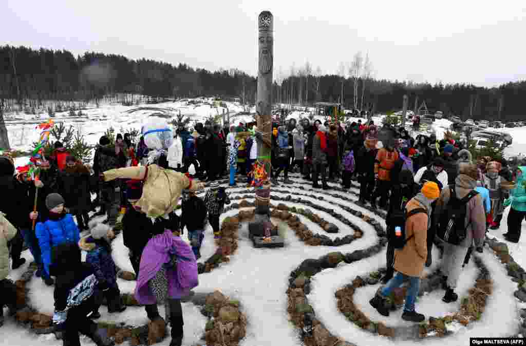 People try to negotiate a stone maze outside St. Petersburg.