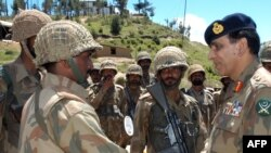 Army chief General Ashfaq Parvez Kayani (right) with troops in Swat Valley in mid-May
