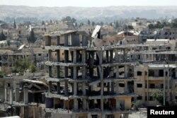 Ракка шаарынын талкаланган көрүнүшү, Сирия.