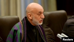 Afghan President Hamid Karzai is constitutionally barred from seeking a third term.