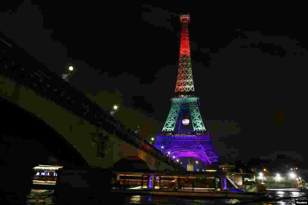 The Eiffel Tower in Paris is illuminated in the colors of the rainbow gay-pride flag in memory of the 49 victims of the massacre at a gay nightclub in Orlando. (Reuters/Gonzalo Fuentes)