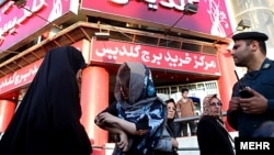 "Tehran police round up women for their ""inappropriate"" dress in July 2012."