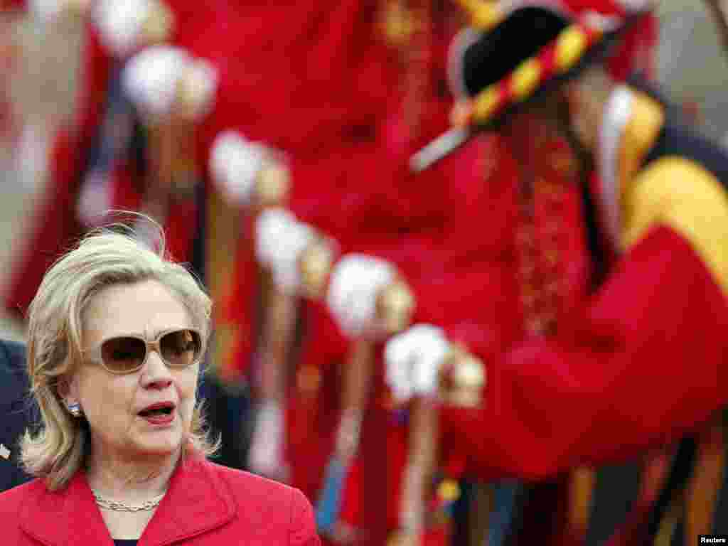 U.S. Secretary of State Hillary Clinton walks past South Korean honor guards wearing traditional costumes, at a military airport in Seongnam, near Seoul, on July 21. Photo by Jo Yong-Hak for Reuters