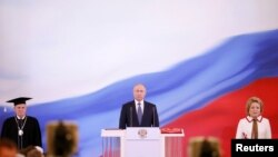 Vladimir Putin (center) is sworn as Russian president during a ceremony at the Kremlin in Moscow on May 7.