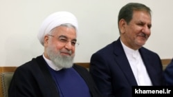 Eshagh Jahangiri (right) with outgoing Iranian President Hassan Rouhani. (file photo)