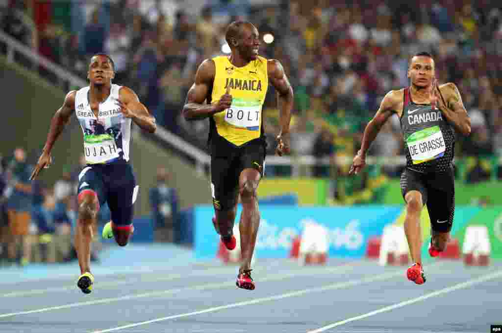 (Left to right;) Chijindu Ujah of Britain, Usain Bolt of Jamaica, and Andre de Grasse of Canada compete during the men's 100-meter semifinals at the Summer Olympics in Rio de Janeiro. (epa/Srdjan Suki)