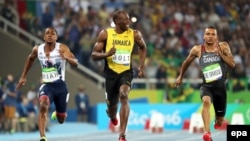 Sprinting legend Usain Bolt leads the field during an Olympic race. He became the first to win double gold medals in sprinting three times.