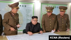 NORTH KOREA -- North Korean leader Kim Jong Un visits the Command of the Strategic Force of the Korean People's Army (KPA) in an unknown location, undated