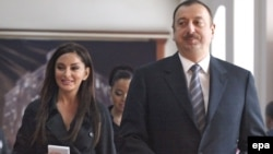 President Ilham Aliyev and his wife, Mehribon Aliyeva, at a polling station for the March 18 referendum