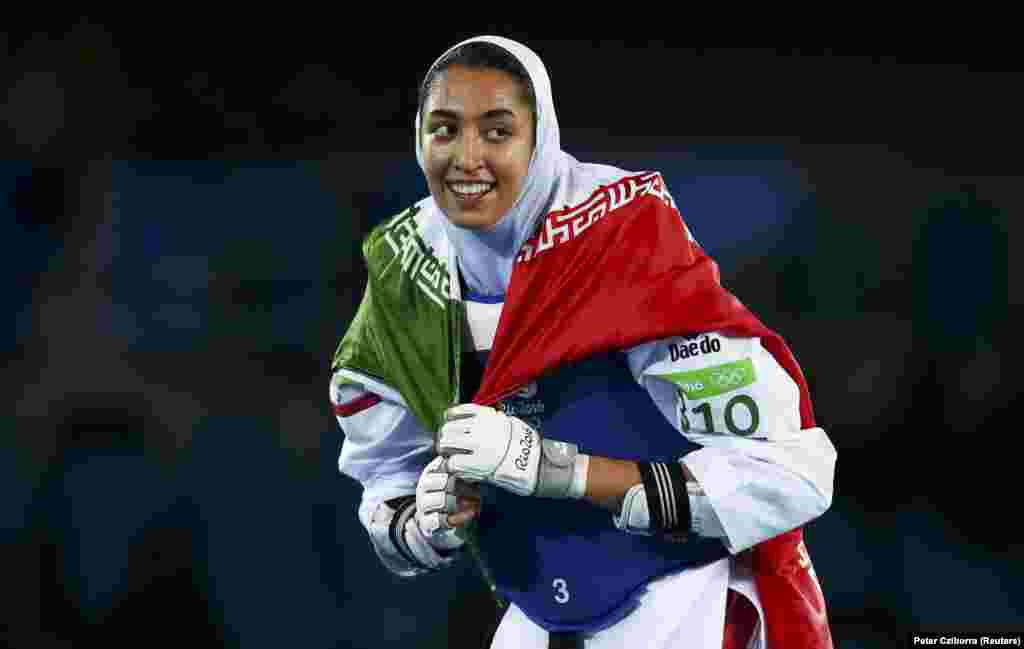 Kimia Alizadeh Zenoorin of Iran celebrates after becoming the first Iranian woman to win a medal in an Olympic event. Alizadeh defeated Sweden's Nikita Glasnovic​ to win bronze in the women's 57-kilogram taekwondo.