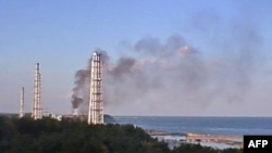 Black smoke rises from reactor no. 3 of the Fukushima nuclear power plant.