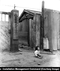 A South Korean child sits alone on a street during fighting in Inchon in 1951.