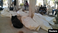Bodies at a cemetery in the Qabon district of Damascus on July 22