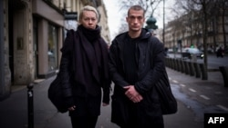 Russian performance artist Pyotr Pavlenski (right) and his partner, Oksana Chaliguina, in Paris in January