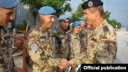 Afghanistan - A German army general gives medals to Armenian soldiers serving in Afghanistan.