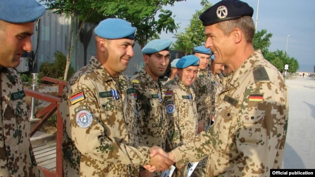 Armenia -- A German army general gives medals to Armenian soldiers serving in Afghanistan.
