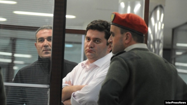Georgian former Interior Minister Bacho Akhalaia (center) in police custody.