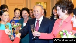 Kazakh President Nursultan Nazarbaev (center) made his remarks at a gathering of women assembled for International Women's Day on March 7. (file photo)