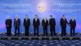 Russian President Vladimir Putin, Chinese President Xi Jinping, Kyrgyz President Sooronbai Jeenbekov, and the leaders of other SCO member states -- Kazakhstan, Tajikistan, Uzbekistan, India, and Pakistan -- were meeting behind closed doors on June 14.