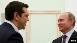 Прем'єр-міністр Греції Алексіс Ципрас (Л) і президент Росії Володимир Путін