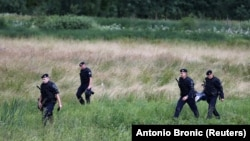 Croatia's police are seen next to the border with Bosnia-Herzegovina in Maljevac, Croatia, on June 18.