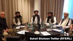 FILE: U.S. peace envoy Zalmay Khalilzad with Taliban leader Mullah Abdul Ghani Baradar and his team during a telephone conversation with the U.S. President Donald Trump in Qatar in March.
