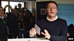 Italian Prime Minister Matteo Renzi casts his ballot in a polling station during the referendum on the government's constitutional reform in Pontassieve, near Florence, on December 4.