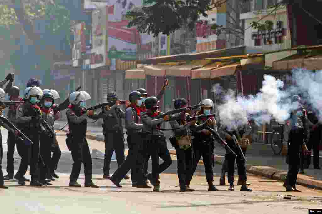 BURMA -- Riot police officers fire teargas canisters during a protest against the military coup in Yangon, Myanmar, February 28, 2021.