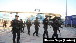 Albanian police patrol outside the Elbasan Arena during an October match with Serbia