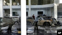 In this Monday, Sept. 17, 2018 photo, imported cars are displayed at a showroom in Tehran, Iran.