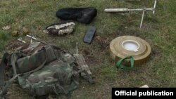 Nagorno-Karabakh - A backpack, landmine, hand grenades and other ammunition which the Karabakh Armenian army claims were left behind by an Azerbaijani commando unit after a failed raid on its positions, 17Dec2015.