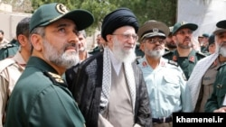 Iran's Supreme Leader Ali Khamenei (C) and Iranian military officials inclouding Amir-Ali Hajizadeh, the commander of IRGC's Aerospace Force, on May 11, 2014.