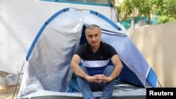 Omid Tootian, an Iranian musician, sits in a tent inside the UN buffer zone at Ledra Palace in Nicosia, Cyprus, September 27, 2020.