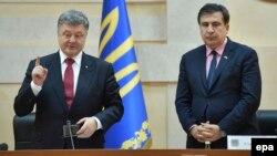 Ukrainian President Petro Poroshenko (left) presents former Georgian President Mikheil Saakashvili as the governor of Odesa on May 30, 2015.
