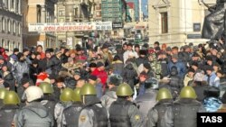 Riot police face off against protesters in Vladivostok.
