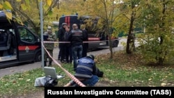 Investigative Committee officers work at the scene of Interior Ministry investigator Yevgenia Shishkina's death in the Krasnogorsk district outside Moscow on October 10.