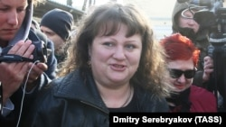 Oksana Sevastidi, a shopkeeper from the Black Sea resort city of Sochi, is released from prison after being pardoned by Russian President on March 12.