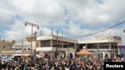 "People shout ""freedom"" during a protest in the Dael region"