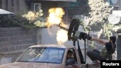 Сирияда үкімет күштеріне қарсы соғысып жүрген адамдар. (Көрнекі сурет)