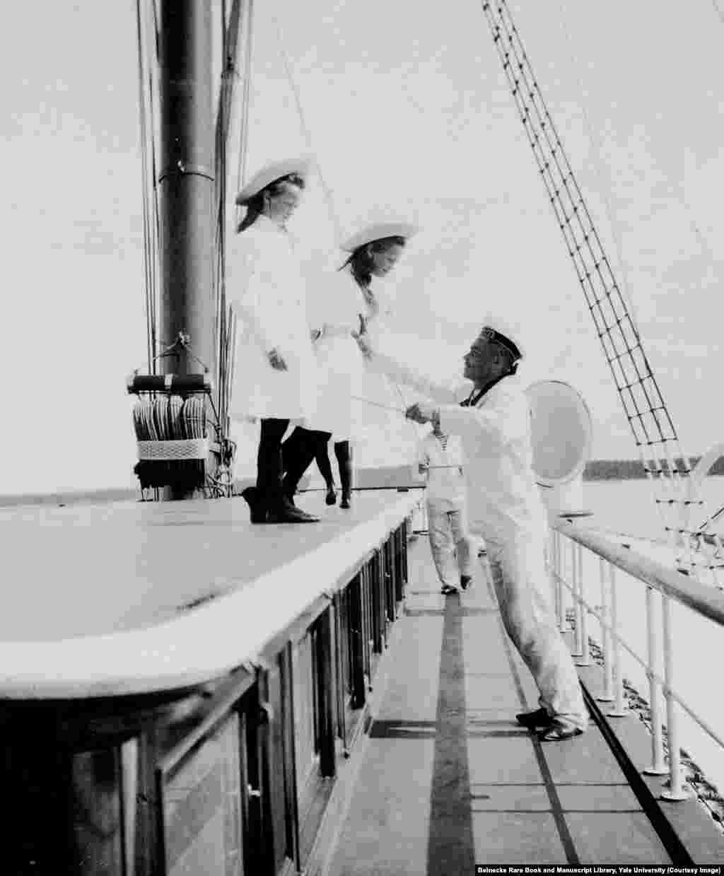 Two of the grand duchesses aboard the Standart. When the children were small, each was assigned a sailor to ensure they didn't fall overboard.