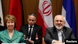 European Union foreign policy chief Catherine Ashton (left) and Iranian Foreign Minister Mohammad Javad Zarif smile at the start of a conference in Vienna on March 18.
