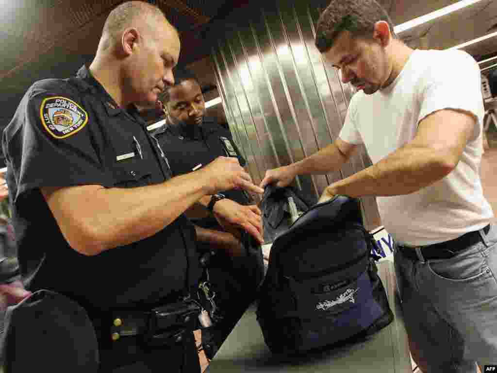New York Police Department officers check bags during the morning commute at Grand Central Terminal in New York City.