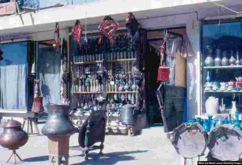 A store displaying traditional wares. The 1979 assassination of President Amin and the chaos that followed would eventually lead to the Soviet occupation of Afghanistan, years of civil war, and the U.S.-led invasion in 2001.