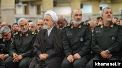 IRGC's top commanders attending a meeting with Supreme Leader Ali Khamenei, undated. In this middle: Khamenei's representative to the IRGC, Ali Saeedi