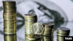 Первый день после выборов в США рубль, как и цены на нефть, завершил на уровнях, близких к отмеченным накануне