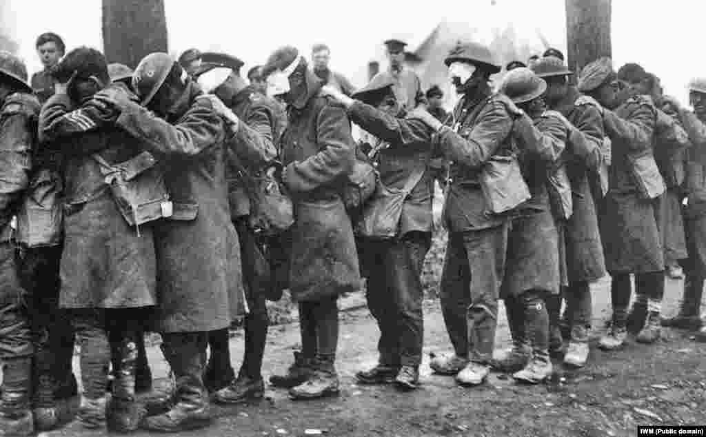 British 55th Division troops blinded by tear gas await treatment at an Advanced Dressing Station near Bethune, France during the Battle of Estaires on April 10, 1918, as part of the German offensive in Flanders.