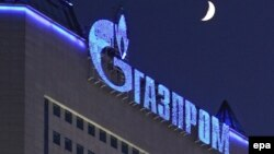 Russia -- The logo of gas company Gazprom illuminated on Gazprom headquarters in Moscow, 02Jan2009