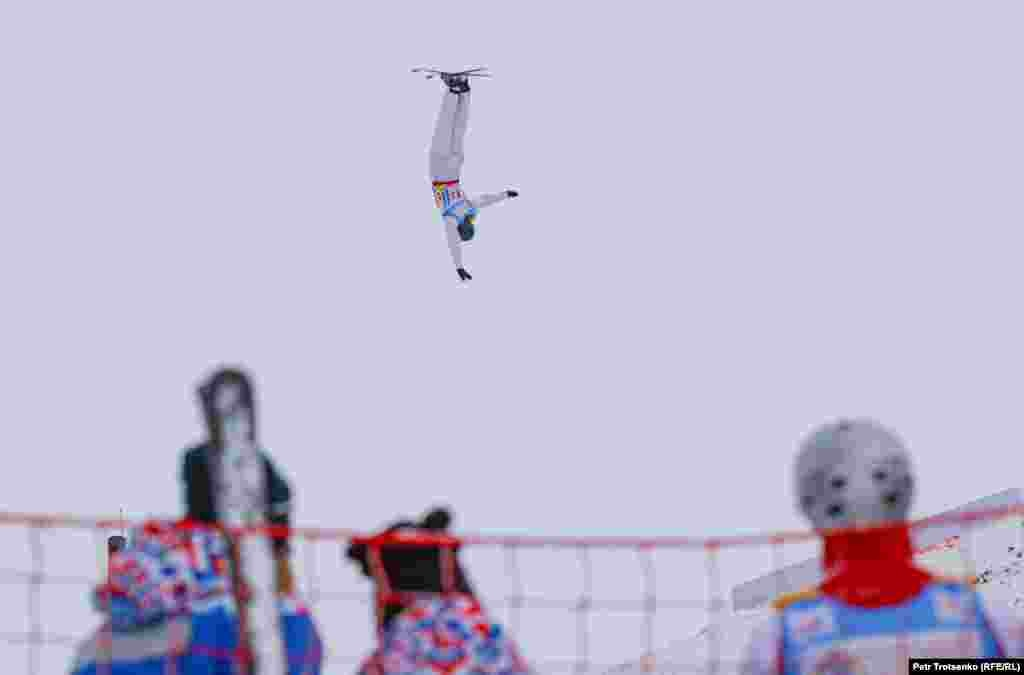 A skier is captured upside down, suspended in midair, in this snap from the competition.